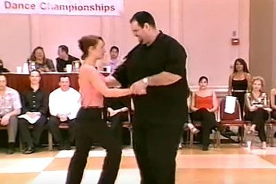 Large Man Grabs Her To Dance, His Next Move Had Everyone On Their Feet Cheering
