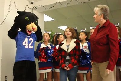 Mascot Comes In Class Of Students. When She Drops Her Mask, Girl Next To Her Loses It!