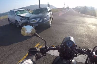Motorcyclist's Leg Gets Crushed By Car, Helmet Camera Captures Everything