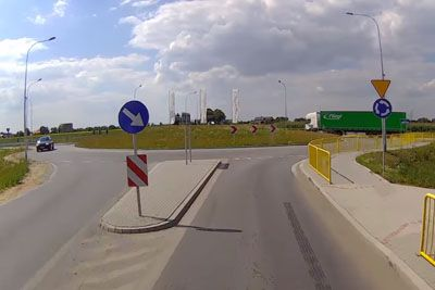 Polish Driver Recives A Shock Of His Life Moments After Driving On Roundabout