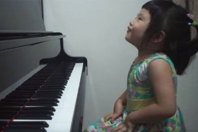 Adorable 3-Year-Old Giggles At Piano, Then Blows Internet Away With Her Talent