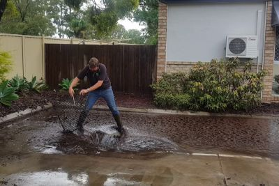 Plumber Clearing A Blocked Grate After Storm Looks So Satisfying