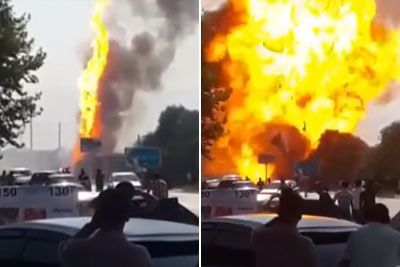 Huge Fuel Tank Explosion Sends Onlookers Running For Their Life