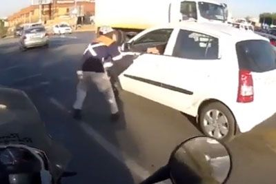 Biker Delivers Instant Karma, Saves A Driver From Being Robbed