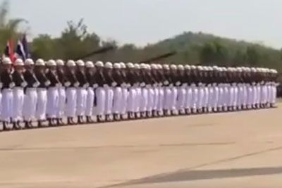 Dozens Of Soldiers Line Up In Unison But Focus On Man On Left As He Jumps In The Air