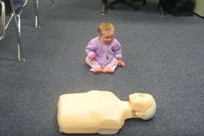 Baby Girl Locks Eyes With CPR Dummy Inspiring Everyone Instant She