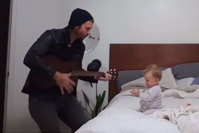When Her Dad Begins To Play The Guitar, This Baby Girl Has The Best Reaction Ever