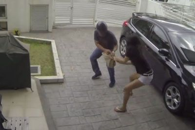 Thief Tries To Snatch Woman's Purse, Gets So Much More Than He Bargained For