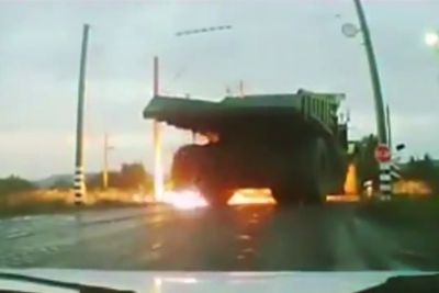 Large Dump Truck Drives Into High Voltage Power Line, Tires Explode