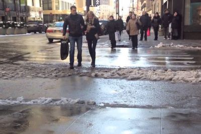 People Getting Their Feet Soaked In A Very Pavement-Looking Puddle In NYC