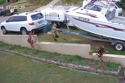 Man Desperately Clings To His His Runaway Boat As It Takes Off Down The Street