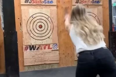 Woman Nearly Takes An Axe To The Head Playing Dangerous Game