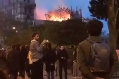 Crowd Sings Ave Maria Outside Of Notre Dame Cathedral During The Devastating Fire
