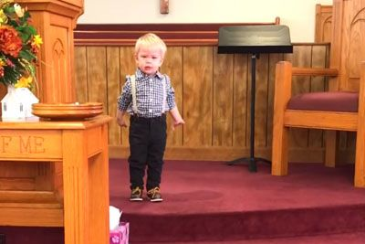 Pastors Son Hops Up On Stage Before Service, Delivers Sermon That Has Entire Church In Stitches