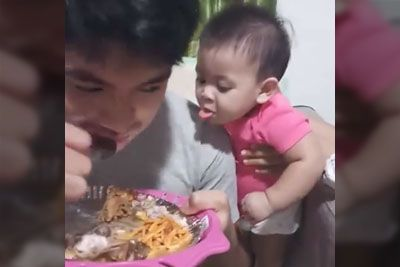 Toddler Makes Hilarious Expressions While Watching His Father Eating A Meal