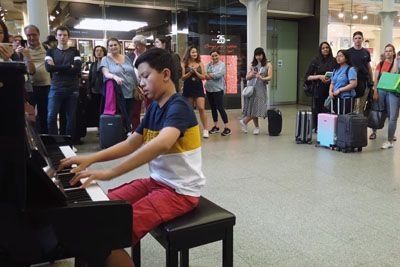 Boy Gets Interrupted While Playing Bohemian Rhapsody On A Piano In London