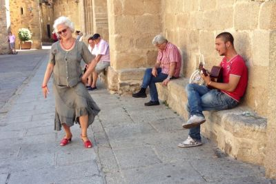 Spanish Old Lady Joins Street Musician During Flamenco Performance