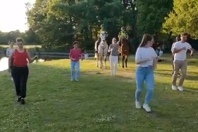 Dutch Mounted Police Joins Outdoor Salsa Class In Park