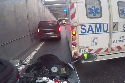 French Biker Escorts Ambulance In Traffic