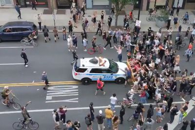Videos Show NYPD Cruisers Ramming Into Protesters Behind A Barricade