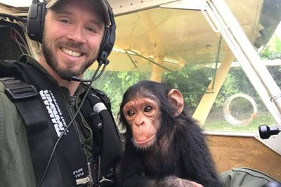 Pilot Flies With Rescued Baby Chimpanzee For The Sweetest Reason