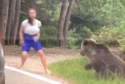 Woman Makes The Bad Decision To Take Picture With Bear