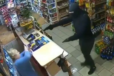 Lady Gives Lesson To An Armed Robber Inside A Shop