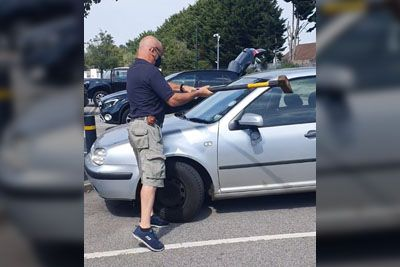 Man Smashes Car Window With An Axe To Rescue Dog Trapped Inside