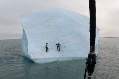 Two Guys Climb An Iceberg, Then It Overturns Into The Sea