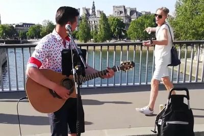 A Busker Sings Queen, When Suddenly A Passer-By Begins To Dance