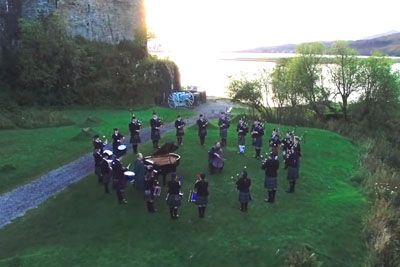Bagpipe Players Form A Circle By The Forest To Perform