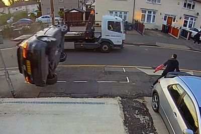 Car Flips Over, Almost Hits A Pedestrian On The Sidewalk