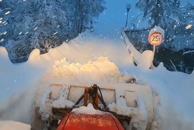 Austrian Man Sits In Tractor To Plow 2 Meters Of Fresh Snow
