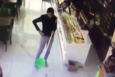 Man Sweeping Floor Loses His Broom