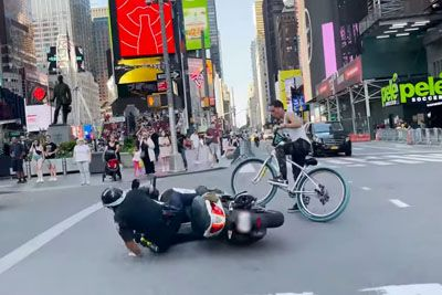 Cop On Scooter Falls Thanks To Guy Doing Wheelie