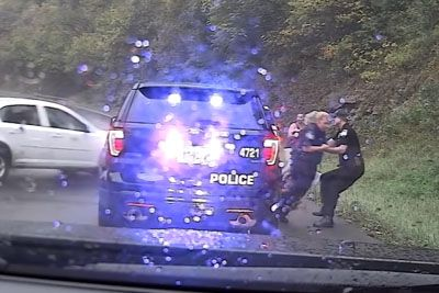 Quick Acting Cop Saves Co-Worker From Oncoming Car