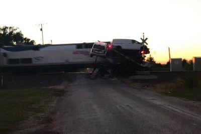 Passenger Train Absolutely Demolishes Car Transporter Truck